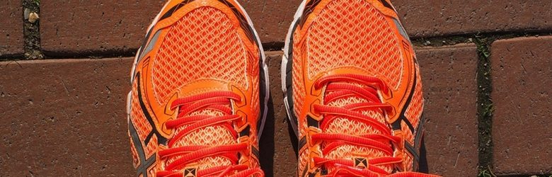 pair of bright orange trainers on the ground