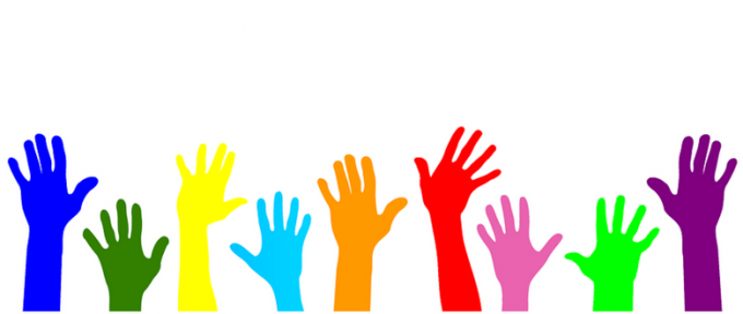 colourful graphic of hands in the air to volunteer