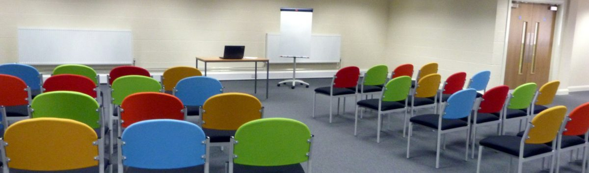 training room at redbank house with chairs and laptop