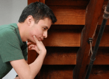 man thinking feeling anxious by stairwell