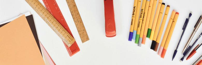 rulers stapler pens and paper
