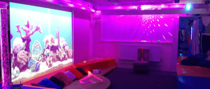 multisensory room redbank house with purple lighting and fish projection screen