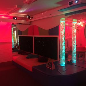 multi-sensory room at redbank house with waterbed and bubble tubes