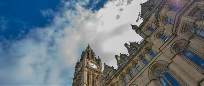manchester town hall with cloudy sky