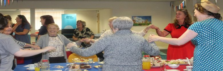 guests dancing at disabled living tea dance