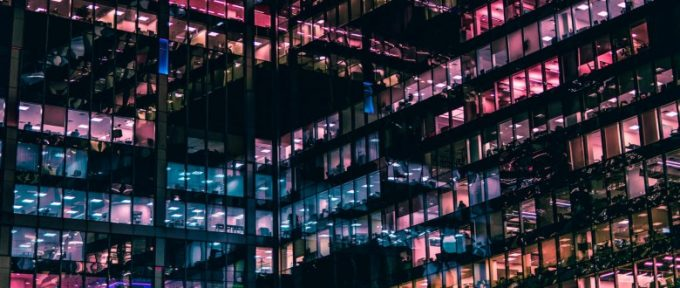 colourful windows of high rise office at night