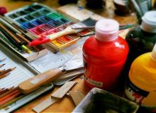 colourful bottles of paint and pack of water colours