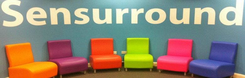 colourful chairs and senurround sign redbank house