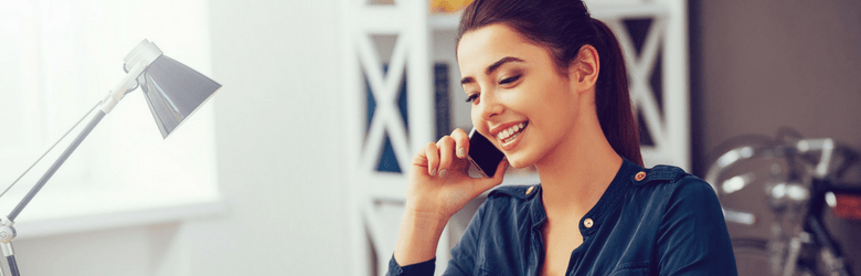 woman relaxed on the telephone in office