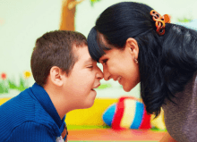 mother and son with cerebral palsy smiling