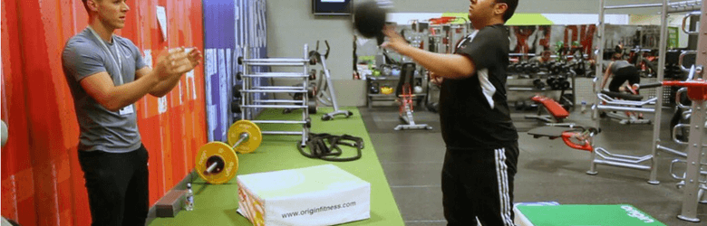 ben andrews in the gym helping disabled person