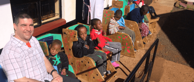 children on chairs in kenya