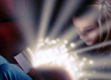 young girl reading a book looking magical
