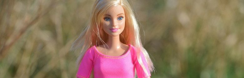 Photo of barbie doll wearing pink top