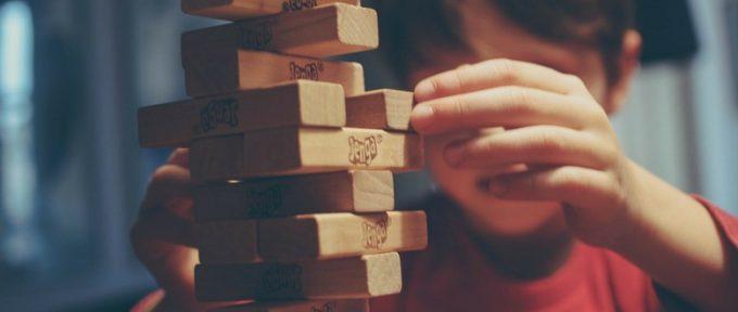 little boy playing jenga