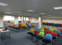 training room 2 at redbank house in manchester with colourful chairs and space