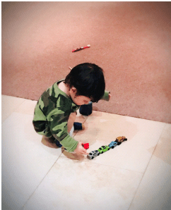 franklin playing with his toy cars