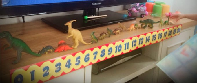 toy animals and numbers in a row