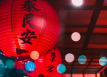 chinese latern hanging from ceiling with spotlights