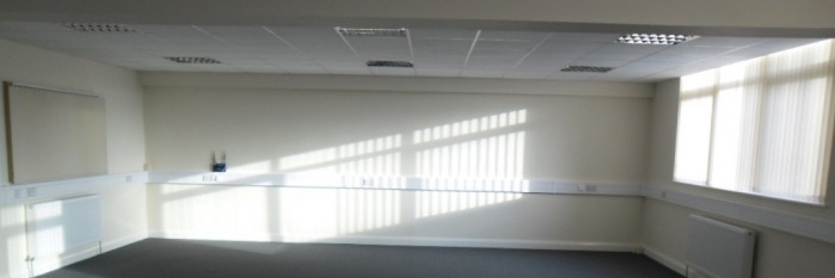 light shining through window in empty office space