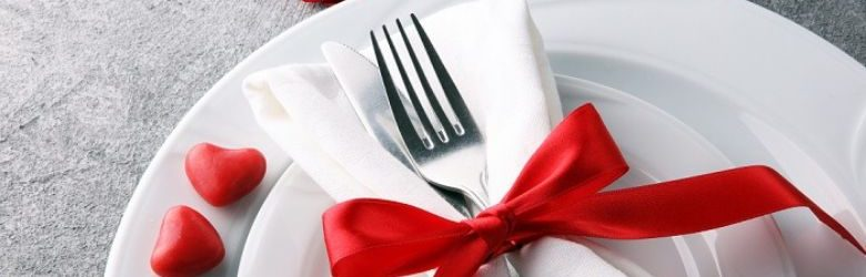 valentines meal table setting with ribbon on fork