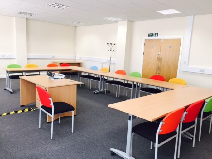 training room with u-shaped layout desk and chairs